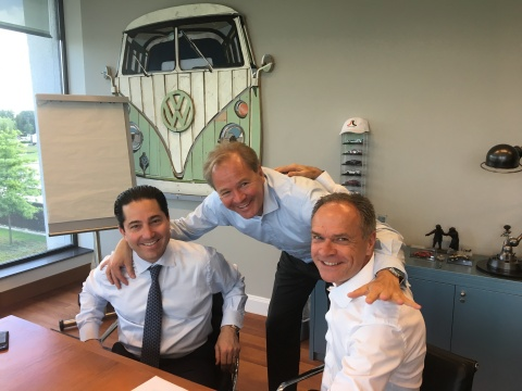 Pictured L to R: Todd Blue, Founder and CEO of The indiGO Auto Group; Janus Smallbraak, CEO Pon Holdings, Paul Van Splunteren, President of Pon Luxury Cars (Photo: Business Wire)