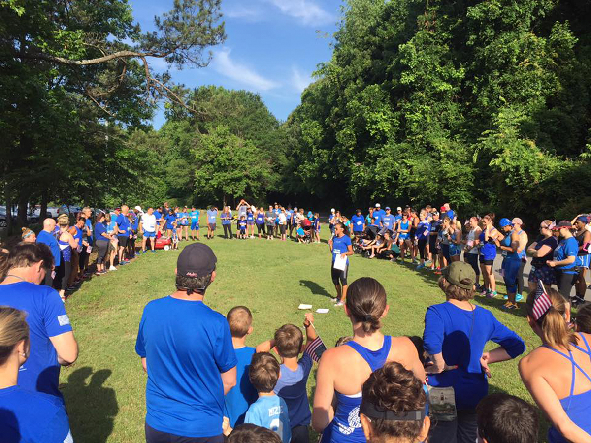 Participants at the wear blue: run to remember gather for the Circle of Remembrance in recognition of military members killed in action. (Photo: Business Wire)