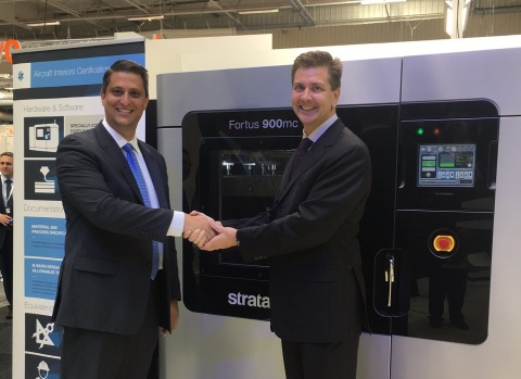 Scott Sevcik, Head of Aerospace, Defense and Automotive Solutions, Stratasys (on left) congratulates Collin Wilkerson, Managing Director, Western Tool & Mold on his company's purchase of the Stratasys Fortus 900mc Aircraft Interiors Certification Solution (Photo: Business Wire)