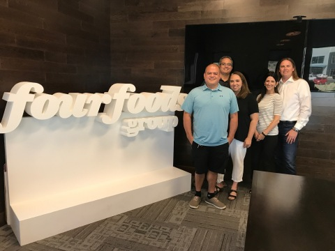 Mo'Bettahs acquired by Four Foods Group. L to R: Kalani Mack, Kimo Mack and Tami Mack from Mo'Bettahs with Shauna Smith and Andrew K. Smith of Four Foods Group. (Photo: Business Wire)
