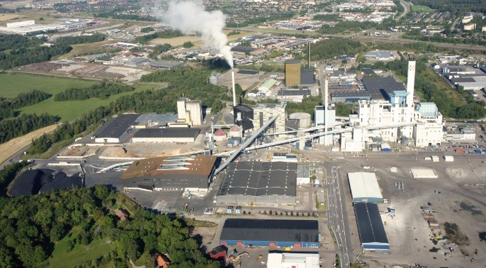 Photo montage by Scheiwiller Svensson Arkitektkontor AB. The image shows the location of block 7, golden and black colored building beyond the power plant, seen from the south.