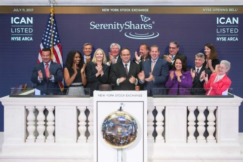 """SerenityShares rings the bell at the NYSE. The Washington, DC-based firm recently launched its IMPACT ETF (NYSE Arca: """"ICAN""""), a liquid, broadly-diversified fund employing a methodology that breaks the U.N. SDGs into 20 categories that center on solutions-focused investments in clean water, green transportation, organic foods, elder care, local access to health care and other goals. (Photo Credit: NYSE)"""
