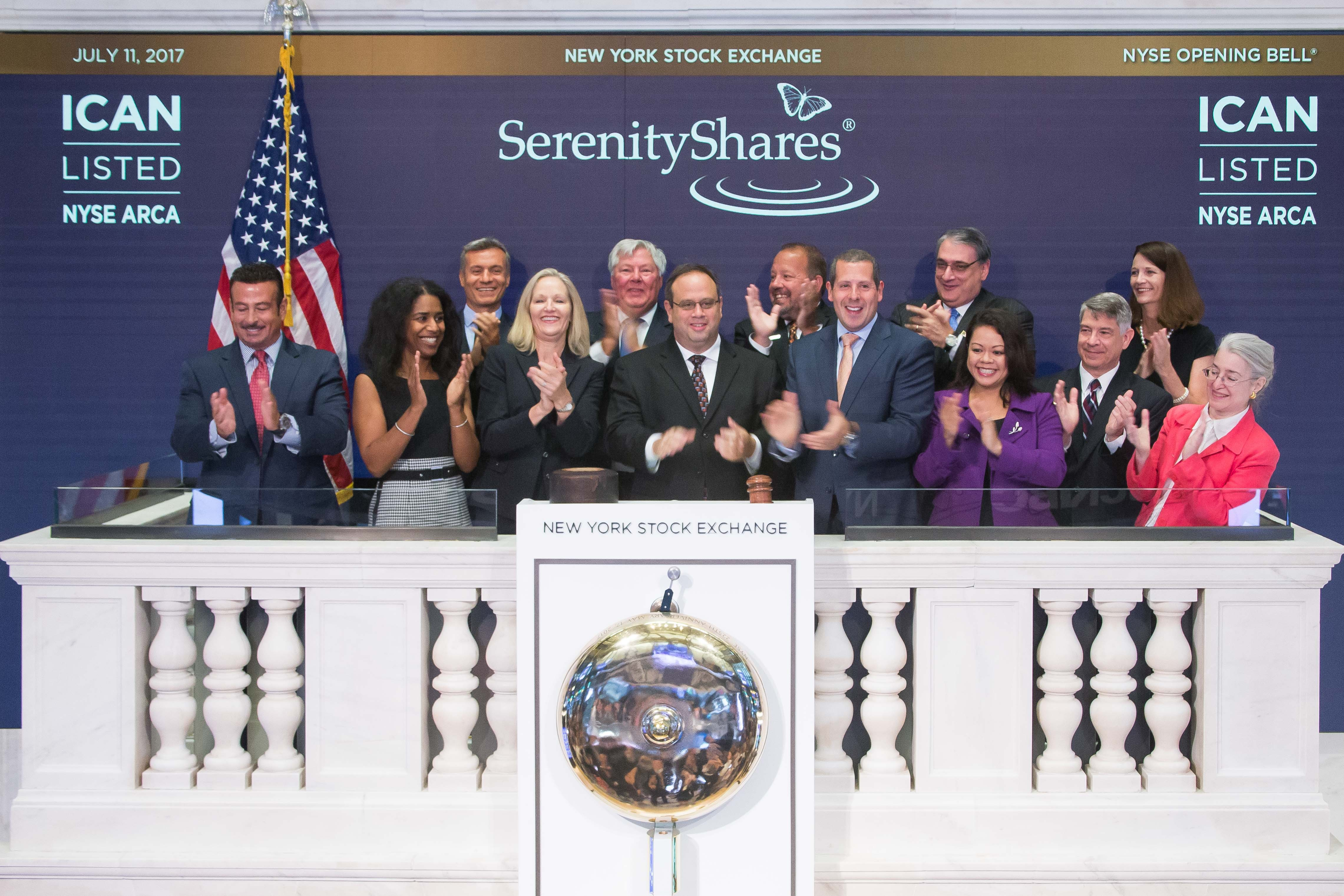 "SerenityShares rings the bell at the NYSE. The Washington, DC-based firm recently launched its IMPACT ETF (NYSE Arca: ""ICAN""), a liquid, broadly-diversified fund employing a methodology that breaks the U.N. SDGs into 20 categories that center on solutions-focused investments in clean water, green transportation, organic foods, elder care, local access to health care and other goals. (Photo Credit: NYSE)"