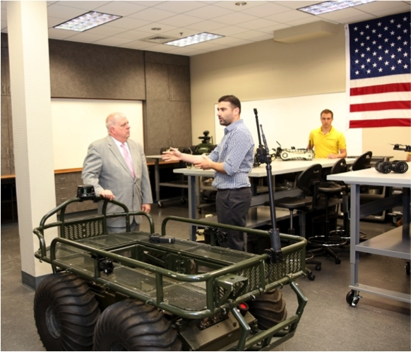 Shahar Abuhazira, CEO of Roboteam and Maryland Governor Larry Hogan in front of the PROBOT. (Photo: Business Wire)