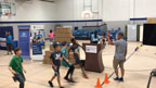 """UnitedHealthcare donated 150 NERF Energy Game Kits to the Boys & Girls Clubs of Central New Mexico as part of a national initiative to encourage young people to become more active through """"exergaming."""" Charles Milligan Jr., CEO, UnitedHealthcare Community Plan of New Mexico, was joined by Albuquerque Sol FC's president, Ron Patel, and general manager Larry Espinoza as midfielder Tommy Ramos led club members through exercises and drills to showcase the activity tracker and mobile game. UnitedHealthcare is delivering a total of 10,000 NERF ENERGY Game Kits throughout the year to elementary schools and community organizations across the country, enabling children ages six to 12 to receive the kits at no cost (Video: Anita Sen)."""