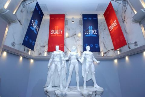 Six Flags Magic Mountain's new JUSTICE LEAGUE: Battle for Metropolis attraction features impressive white marble statues of the DC Trinity; Superman, Wonder Woman, and Batman, as well as flags that proclaim what the Justice League stands for; Truth, Equality, Justice, Courage, and Hope. (Photo: Business Wire)