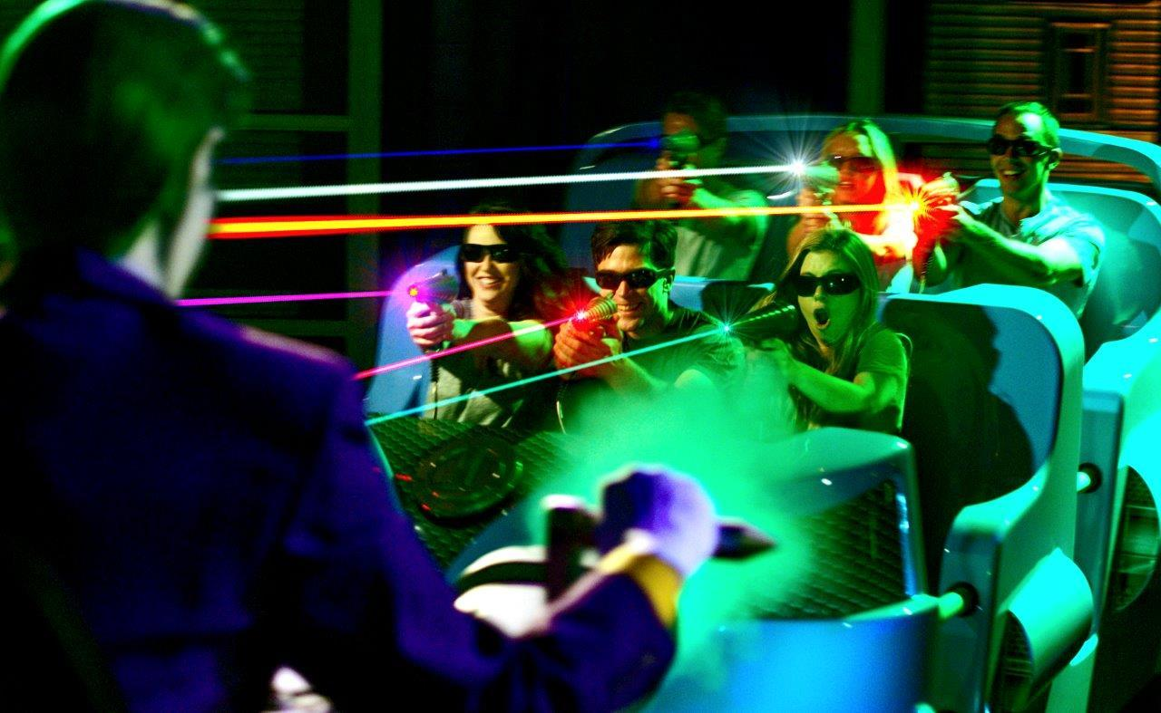 Riders on Six Flags Magic Mountain's new JUSTICE LEAGUE: Battle for Metropolis attraction battle alongside iconic DC Super Heroes to save the city of Metropolis. The next generation of this award-winning interactive attraction immerses players into the DC Universe featuring the latest state-of-the-art gaming and dark ride technology. (Photo: Business Wire)
