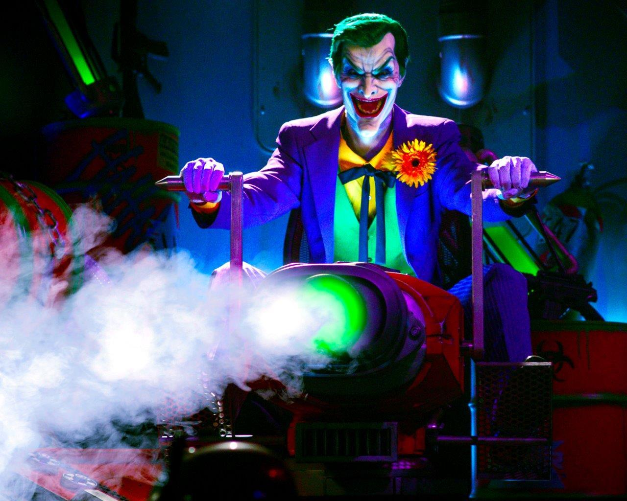 The Joker sprays laughing gas on riders at Six Flags Magic Mountain's new JUSTICE LEAGUE: Battle for Metropolis attraction. Riders are members of the JUSTICE LEAGUE Reserve Team to save the City of Metropolis with climactic interactive battle scenes between the DC Super Heroes and Super-Villains. (Photo: Business Wire)