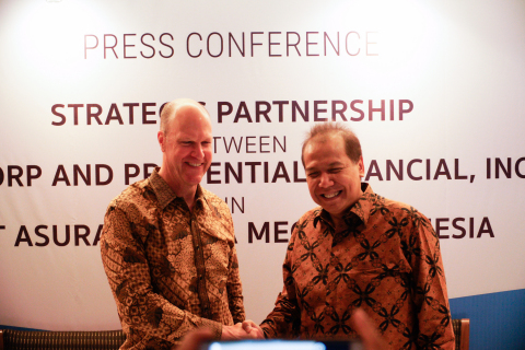 Charles Lowrey, executive vice president and chief operating officer of PFI's International Insurance businesses, and CTCorp Chairman and Founder Chairul Tanjung shake hands after announcing a joint venture between the two companies to provide life insurance to a broad spectrum of people in Indonesia. The partnership, announced July 18 at a press conference in Jakarta,  leverages PFI's insurance expertise and advances its business growth strategy through alignment with market insights from CT Corp, Indonesia's  largest consumer-focused company. (Photo: Business Wire)