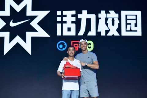 Lv Shaowu, a winner of Nike's Active Schools Innovation Award for Innovation in Culture of Sport, was presented with a pair of CR7 Mercurial Campeões boots by the world's top soccer player Cristiano Ronaldo during the Active Schools Innovation Award ceremony. (Photo: Business Wire)