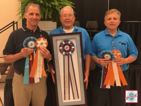 Company Recipients: Joe Santoro, Gary Mantolesky and Richard Bousquet accepting The Chip Festival's Grand Champion Award. (Photo: Business Wire)