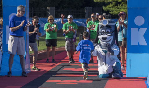 Rick Dunlop, CEO of Medicare & Retirement for UnitedHealthcare of Ohio, and UnitedHealthcare mascot Dr. Health E. Hound congratulated and distributed medals to nearly 120 kids as they crossed the finish line today at the UnitedHealthcare IRONKIDS Ohio Fun Run in Delaware, Ohio. (Credit: Neal Lauron)