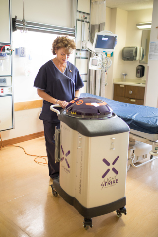 Environmental services staffer Hilda Guzman of Old Bridge prepares the Xenex LightStrike Germ-Zapping Robot for disinfection of a patient room at Saint Peter's University Hospital. (Photo: Business Wire)