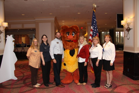 The HomeVestors Legal Department includes Elise Carter, Paralegal; Michelle Holloway, Collections; Anthony Lowenberg, Corporate Counsel; HomeVestors Mascot Ug; Bonnie DePasse, VP and General Counsel; Sherry Wallace, Legal Assistant; and Dawn Williams, Audits (Photo: Business Wire)