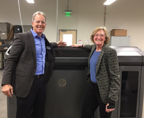 HP's President of 3D Printing, Stephen Nigro, and Proto Labs President & CEO, Vicki Holt, visit a Multi Jet Fusion 3D printer at Proto Labs' 77,000 square foot additive manufacturing facility in Cary, NC. The process has been integrated into Proto Labs' suite of services—which now consists of 10 processes across 3D printing, CNC machining, and injection molding—to provide product developers and engineers with a total solution throughout the entire life cycle of a product. (Photo: Proto Labs)