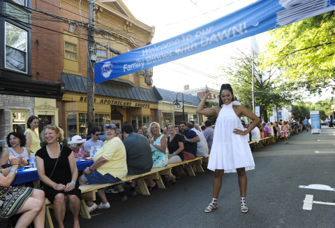 Actress Tia Mowry joins the town of Lambertville, NJ at a 2,000 foot table for the Family Dinner with Dawn event, Sunday, Aug. 13, 2017.  While they ate, Dawn tackled over 6,000 dishes using one 21.6 oz bottle of Dawn. (Photo by Diane Bondareff/Invision for Dawn/AP Images)