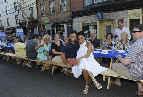 Actress Tia Mowry and the residents of Lambertville, NJ enjoy a three-course meal seated at a 2,000 foot table that extends down five blocks of Union St, Sunday, Aug. 13, 2017. While they ate, Dawn tackled over 6,000 dishes using one 21.6 oz bottle of Dawn. (Photo by Diane Bondareff/Invision for Dawn/AP Images)