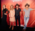Tim McGraw and Faith Hill meet wax figures for the first time on August 5 prior to their sold-out Soul2Soul show in Nashville. (Photo: Business Wire)