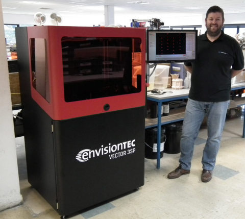 James Blackburn – Sales Director at GoPrint3D with an EnvisonTEC Vector 3SP printer. (Photo: Business Wire)