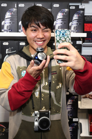 SYDNEY, AUSTRALIA - AUGUST 31: Sydney, Australia – Sept. 1 – Dennis Wong holding the Sphero BB-9E. He was among the very first fans to meet the new Star Wars: The Last Jedi character BB-9E at midnight retail events in Sydney, Australia as Force Friday II gets underway around the world in celebration of the launch of the new product line for Star Wars: The Last Jedi. BB-9E is one of the dark, gleaming BB astromech units of the First Order featured in the upcoming theatrical release, as well as through the range of new products launching globally today. (Photo by Brendon Thorne/Getty Images for Disney Consumer Products and Interactive Media)