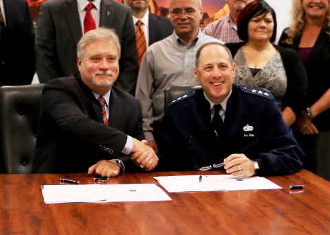 Scott Lehr (L), President, Orbital ATK Flight Systems Group and U.S. Air Force Lt Gen Lee Levy (R) sign Partnership Agreement for strategic teaming to address future composite aerostructure needs. (Photo: Business Wire)