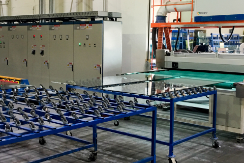 Glass moves to tempering machine after horizontal wash at Triview Glass (Source: SolarWindow Technologies, Inc.)