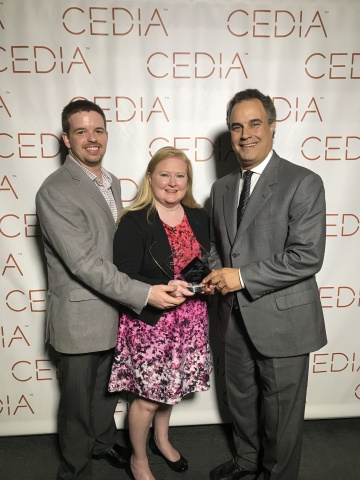 David Pidgeon, Brandi Thompson and Kelly Pittman receiving the esteemed award on behalf of Starpower. (Photo: Business Wire)