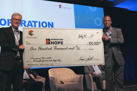 CoreLogic CEO Frank Martell presents John Hope Bryant with $100,000 check toward company's $250,000 donation to HOPE Disaster Fund. (Photo: Business Wire)