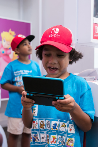 In this photo provided by Nintendo of America, fans gather at the Nintendo NY store for the Nintendo Back-to-School Celebration. Fans played games, received Nintendo school supplies, signed a pledge to work hard this school year and had the chance to have their photo taken with Mario. (Photo: Business Wire)