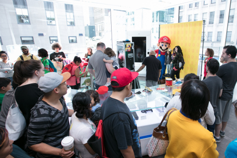 In this photo provided by Nintendo of America, fans gather at the Nintendo NY store for the Nintendo Back-to-School Celebration. Fans played games, received Nintendo school supplies, signed a pledge to work hard this school year and had the chance to have their photo taken with Mario.