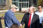 Delaware Senator Chris Coons shakes the hand of retired CSC employee John Pelletier, who managed the NYC office on September 11 and evacuated employees before the South Tower was hit ensuring the safety of everyone in the office that day. (Photo: Business Wire)
