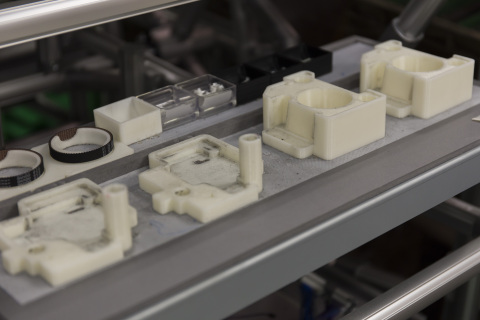 Ricoh's 3D printed jigs and fixtures boost assembly line productivity. These manufacturing aids were produced on the Stratasys Fortus 900mc Production 3D Printer using ABS plastic (Photo: Ricoh)