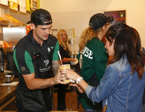 Dallas Stars captain Jamie Benn serves smoothies at Jamba Juice to support the National Multiple Scl ...