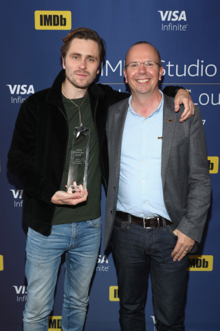"Col Needham (IMDb Founder & CEO) presents Sverrir Gudnason (star of ""Borg/McEnroe"") with the IMDb ""Breakout Star"" STARmeter Award In Toronto At The Visa Infinite Lounge. (Photo: Business Wire)"