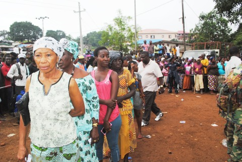 Some of the affected community members wait in line for relief items. (Photo: Business Wire)