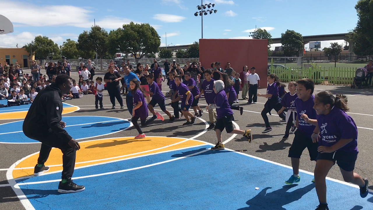Jared Cook of the Oakland Raiders played a game of tag with students at International Community School in Oakland Monday. Cook and UnitedHealthcare employees unveiled new physical education equipment and other beautification projects for students at the school (Video: Matt Rodriguez).