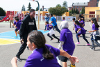 Jared Cook of the Oakland Raiders played a game of tag with students at International Community School in Oakland Monday. Cook and UnitedHealthcare employees unveiled new physical education equipment and other beautification projects for students at the school (Photo: Amy Sullivan).