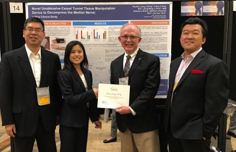 Award Presentation by AANEM President (Photo from L to R: Zong-Ming Li, PhD of Cleveland Clinic, Pauline Luong, ME Lead Author, William S. Pease, MD President of AANEM, and Jae Son, PhD Inventor) (Photo: Business Wire)