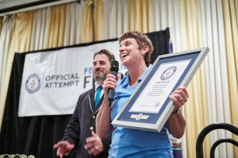 Food Lion President Meg Ham Holds Official Award After Food Lion Sets GUINNESS WORLD RECORDS™ Title for Most Bagged Lunches Assembled in One Hour. Grocer Raises Awareness for Hunger Action Month During Event; Lunches Donated to Local Food Banks (Photo: Business Wire)