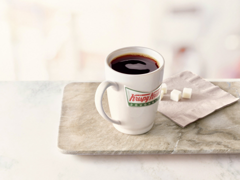 Krispy Kreme Doughnuts announced that it will spread the joy of National Coffee Day over an entire weekend, offering guests one free cup of coffee each day, Friday, Sept. 29 through Sunday, Oct. 1. Customers can enjoy any sized hot brewed or small iced premium blend coffee for free at participating Krispy Kreme shops across the United States and Canada. (Photo: Business Wire)