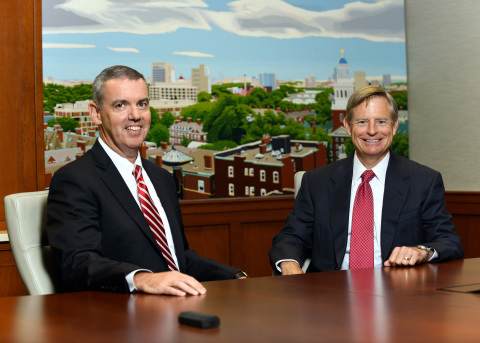 Cambridge Trust Chairman and CEO Denis K. Sheahan (left) welcomes Mark D. Thompson (right) as Presid ...