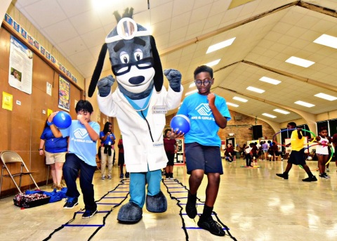 """Nearly 100 members of the Boys & Girls Clubs of Greater Baton Rouge and UnitedHealthcare mascot Dr. Health E. Hound tested out their new NERF ENERGY Game Kit that tracks activity earning """"energy points"""" in order to play the game. The donation is part of a national initiative between Hasbro and UnitedHealthcare, featuring Hasbro's NERF products, that encourages young people to become more active through """"exergaming"""" (Photo: Cheryl Gerber)."""