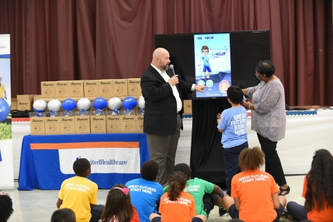 """UnitedHealthcare donated 100 NERF ENERGY Game Kits to the Boys & Girls Clubs of Greater Baton Rouge as part of a national initiative to encourage young people to become more active through """"exergaming."""" Brad Grundmeyer, vice president, UnitedHealthcare Community Plan of Louisiana, demonstrated the NERF ENERGY RUSH app to club members. The donation is part of a recently launched national initiative between Hasbro and UnitedHealthcare, featuring Hasbro's NERF products, that encourages young people to become more active through """"exergaming"""" (Photo: Cheryl Gerber)."""