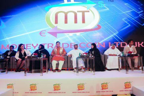 The panel at Money Trade Coin Ltd UK Global Press Conference - Allwyn Prabhakar, Sammar Asaf, Salma Al Ketbi, Amit Lakhanpal, H.E. Sheikh Saqer Al Nahyan, Nada Almawy, Hashim Malik and Taha Kazi (Photo: AETOS Wire)