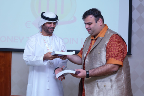 Amit Lakhanpal presents the book 'The World of Cryptocurrency' to H.E. Sheikh Saqer Al Nahyan (Photo: AETOS Wire)