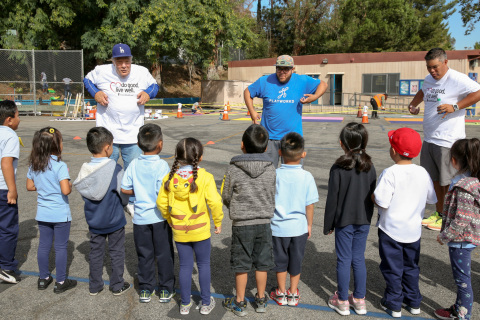 Former Los Angeles Dodgers player Al Ferrara, left, volunteered with Jorge Fuentes of Playworks and Oliver Soria of UnitedHealthcare at Allesandro Elementary School on Monday, Sept. 25. In addition to activities with students, volunteers from UnitedHealthcare worked with the LA Conservation Corps to complete a new walking path at the school (Photo: Jamie Rector).