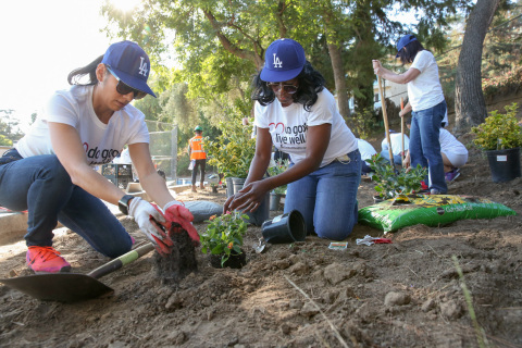 UnitedHealthcare employee volunteers Isabelle Ibarra, left, and April Jones plant flowers at Allesandro Elementary School on Monday, Sept. 25. Volunteers from UnitedHealthcare worked with the LA Conservation Corps to complete a new walking path at the school (Photo: Jamie Rector).