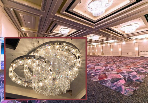 Royal Contract Lighting created twenty-one steel and crystal cluster chandeliers, ranging from eight to ten feet in diameter, for a Flamingo Las Vegas ballroom. (Photo: Business Wire)