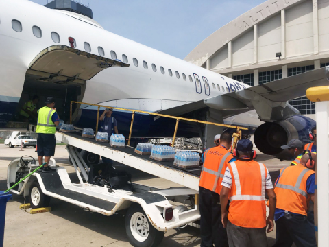 Relief supplies being unloaded on a JetBlue relief flight, the first aircraft to land Aguadilla, Puerto Rico, after Hurricane Maria. (Photo: Business Wire)