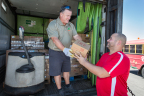 US Foods driver Mike McKeown delivers food to a Feeding America food bank. The company is donating $2 million worth of food to aid Feeding America in its ongoing hurricane relief efforts. (Photo: Business Wire)